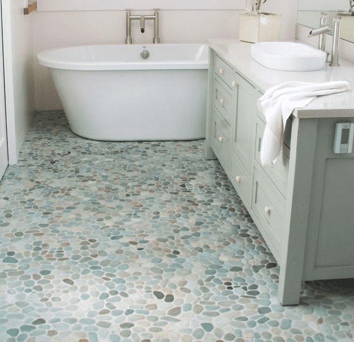 pebble tile and stone mosaics for floors walkways and backsplash in University Place WA